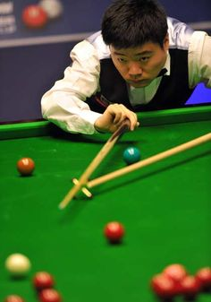 Ding Junhui of China plays a shot during the first round match of the World Championship Snooker tournament against Ryan Day of Wales at the Crucible Theatre in Sheffield, north-west England on April 24, 2012.