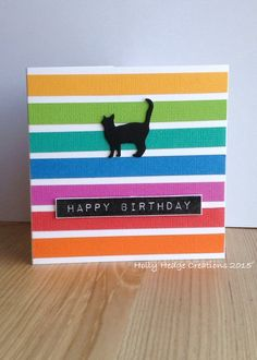 Impression Obsession cat with coloured card strips
