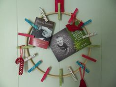 Cute an inexpensive way to display Christmas cards - embroidery hoop, ribbon, & clothespins.  Making this for this Christmas!