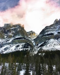Sunset clouds over the mountain peaks... #Banff by iamgalla