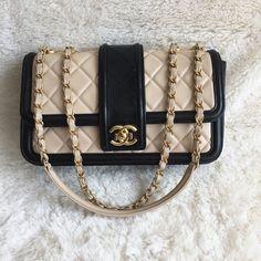 luxuryvintage.my wp-content uploads 2017 07 CHANEL-ELEGANT-CC-BLACK-BEIGE-LAMBSKIN-WITH-MATT-GOLD-HARDWARE-FLAP-BAG-BVKTS-1-2-600x600.jpg?1c3d10
