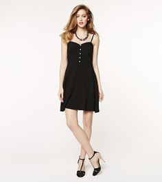 Fun and flirty! This black button down flare dress is perfect for wearing to lunch with the girls!