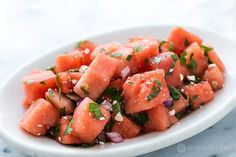 Fresh and delicious and perfect for a hot summer day! Sweet and salty watermelon salad with feta cheese, lime, mint, and parsley. On SimplyRecipes.com