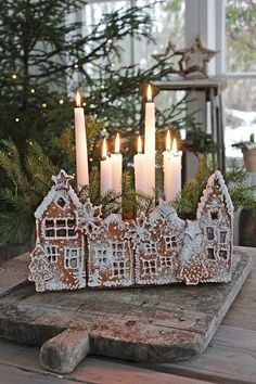 This is really pretty, whimsical, Christmasy. I wouldn't normally do a gingerbread house, too much work, but I might do something like this