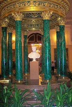 This is the Malachite Room of the Winter Palace, designed by the architect Alexander Briullov in the late 1830s was used as an official drawing-room of Empress Alexandra Fyodorovna, wife of Nicholas I.    The Winter Palace in St Petersburg, Russia was, from 1732 to 1917, the official residence of the Russian Tsars.