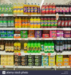 variety-of-soft-drinks-on-supermarket-shelves-EH2FNH.jpg (1300×1390)