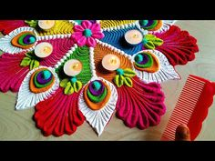 Navratri special Rangoli/peacock feather rangoli using कंघी Easy Rangoli Designs Videos, Rangoli Designs Simple Diwali, Indian Rangoli Designs, Rangoli Designs Latest, Rangoli Designs Flower, Free Hand Rangoli Design, Small Rangoli Design, Rangoli Border Designs, Rangoli Ideas
