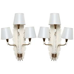 Elegant pair of sconces made in Milan by Arteluce in the 1940's.