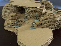 3 Awesome Ways to Make Wargaming Terrain (Cheap, Easy, and Free) - Tangible Day Warhammer Terrain, 40k Terrain, Game Terrain, Wargaming Terrain, Christmas Village Display, Christmas Villages, Warhammer 40k Miniatures, Model Train Layouts, Miniature Crafts