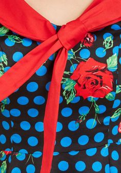 While you offer your expertise on which wine would go well with what meal, your A-line dress offers print mixing advice. Boasting blue dots and red roses atop its black cotton blend, this sailorette-collared number makes an unforgettable - and informative - statement!