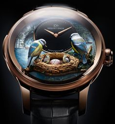 Jaquet Droz The Bird Repeater Watch | A combination of a minute repeater and an automata of birds feeding three chicks, of which one comes out of an egg, while the water of the stream flows in a continuous cascade. The dial is totally done by hand and is incredibly well-detailed. The base dial is mother of pearl, which is hand-engraved and painted. Just 16 pieces will be made, 8 in 18-karat gold and 8 items with diamonds. The price will be close to half a million Swiss francs. |