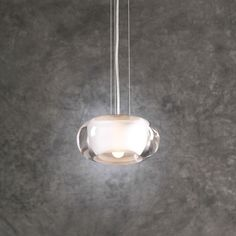 <p> 	Castille pendant features a clear glass with an innner frosted diffuser and a satin nickel finish. Available in a pendant, multi-pendant and wall sconce version. One 40 watt, 120 volt, JCD Type G9 base halogen lamp included. General light distribution. Includes 10 feet of cable and quick grip cable support for quick and easy adjustment. 7 inch diameter x 3.25 inch height.</p>