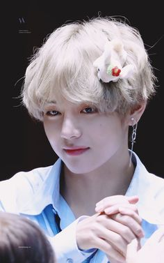Taetae is prettier than the flower on his head
