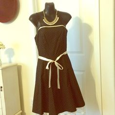 Polka Dot Spaghetti Strap Party Dress Black with white polka dots spaghetti strap dress. Flared skirt with crinoline underlay and sash. Only worn once for a wedding. Additional pictures available upon request. Pulse Dresses Midi