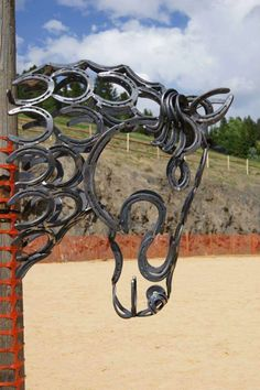 Scrap metal work horse sculpture old tractor parts for Cool things made out of horseshoes