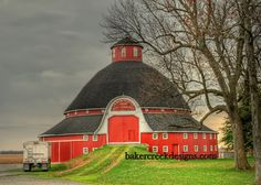 Red Round Barn built in 1908.This round barn is located in the Indian Lake Region of northwest central Ohio. It is part of the Maple Avenue Farm which was owned by J.H.Manchester. The barn was built in 1908 by Horace Duncan.