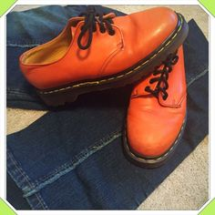 JUST IN Funky orange Doc Martens Orange Doc Martens. Size 6 England, size 8.5 American. Worn only a few times & in great condition. Few scuffs on front, as pictured. Bundle to save! NO TRADES, no modeling. Reasonable offers welcome thru offer button. Doc Martens Shoes