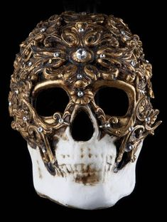 Amazing Demone skull Venetian designer masquerade mask which has a distressed white / gold leaf hand painted base with gold baroque and swarovski crystal detailing ......Stunning and different masquerade mask for men and women. This designer mask has been handmade in the genuine Venetian tradition using a antique papier-mache former with hand torn strips of paper by the best mask makers in Venice (there are slightly cheaper skull masks but this is the genuine article!)....It is aged so will…
