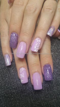 Lilac gel polish with glitter and freehand stencil rose nail art