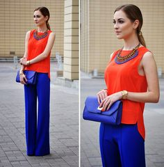 cobalt pants outfit with orange top and cobalt clutch This would look gorgeous on you! Cobalt Pants Outfit, Cobalt Blue Pants, Orange Pants Outfit, Bright Blue Pants, Outfits With Green Pants, Blue Dress Pants, Blouse Outfit, Gray Pants, Long Pants