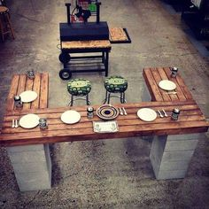 great patio or deck idea using stacked cinder blocks and recycled pallets/wood