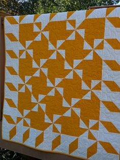 Colored differently, you could make it look like another block on point instead of pinwheels alternating with a plain square. Cheddar Pinwheels by Nettie's Quilts