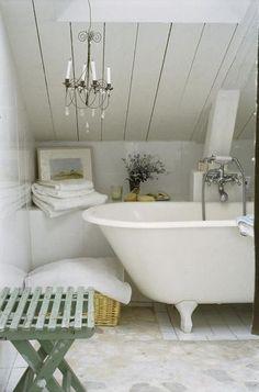 clawfoot tub, chandelier