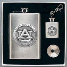 Auburn Tigers Flask & Funnel Set (in Gift Box) - NCAA College Athletics by Heritage Metalworks. $44.95. The Flasks and Funnel Set includes an 8 oz. Flask, a funnel and a 1 oz flask keychain. Decorated with a college sport team applique, this gift can be enjoyed by all fans.. Save 25% Off!