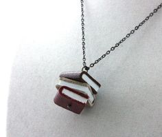 Books on a necklace? Awesome.