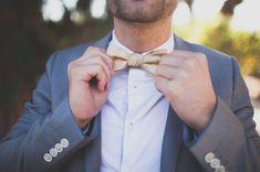 Gold bow tie & grey suit