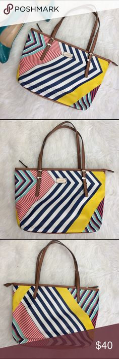 """Nine West Striped Nautical purse Adorable little purse to brighten up your wardrobe! Nautical theme with blue, yellow, and red accented by brown. Lots of pockets and compartments!  Purse is approx 13""""x9""""  Good used condition.  Minor wear to four corners and spots inside (possibly could be removed) Nine West Bags Shoulder Bags"""