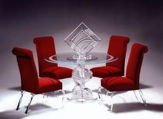 This is such a cool see-through table that was made with plastic fabrication. I love the diamond shape in the middle and the legs are fun and curvy. The red chairs also look nice next to is, and I liked how the chair legs match the table. Lucite Furniture, Acrylic Furniture, Glass Furniture, Dining Room Furniture, Glass Chair, Glass Dining Table, Dining Table Chairs, Glass Tables, Dining Sets