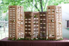 "loveforweddings: Old shutters propped up on a table with guests escort cards create height which can solve the problem of ""no hanging of any kind"" in some venues (like mine). Wedding Table Assignments, Wedding Table Seating, Reception Seating, Reception Ideas, Vintage Shutters, Old Shutters, Window Shutters, Small Shutters, Wooden Shutters"