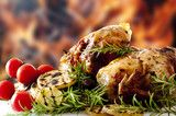 barbecued chicken legs rosemary tomatoes and patatoes