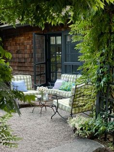 Cushions covered in an outdoor gingham fabric from Scalamandré brighten up the vintage wrought-iron seating on the patio of this Rhode Island retreat. Read more: Porch and Patio Decorating Ideas - Outdoor Room Ideas - Country Living💚 Outdoor Rooms, Outdoor Gardens, Outdoor Living, Outdoor Furniture Sets, Outdoor Decor, Iron Furniture, Outdoor Seating, Outdoor Patios, Garden Furniture