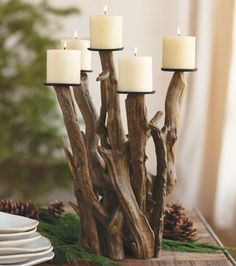 Dark Driftwood Candelabra: Naturally sculpted and worn smooth by wind and seawater, entwined pieces of driftwood form a dramatic candelabra centerpiece that holds seven pillar candles. No two alike.