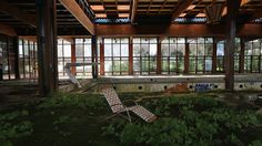 A lawn chair sits as nature takes over the indoor pool area of Grossinger's Catskill Resort Hotel on July 5, 2012 in Liberty, New York