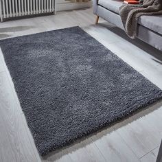 Softness shaggy rugs feature an immensely soft and silky charcoal coloured pile which will be super soft under foot.