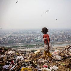 Photo by Stephanie Sinclair Ghazipur landfill, 70 acres of trash in Delhi, India, provides a hunting ground for seven-year-old Zarina, who salvages items to sell.