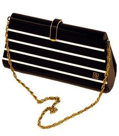 ShopCurious - Pierre Cardin - Vintage black and white lucite handbag with chain strap