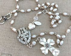 This gorgeous, handmade design is a vintage repurposed Art Deco rhinestone necklace. This Art Deco necklace is a one of a kind (OOAK) design and can be worn for a special occasion or casual with a T-shirt and jeans. This necklace features a repurposed Art