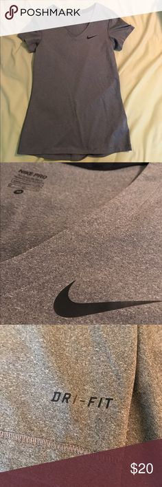 Nike Pro Dri- Fit Grey V-neck This shirt is good as new! Has only been worn a few times, no stains, tears, loose threads. It's dri-fit so great for sweat wicking workouts and it is fitted.  Nike Tops Muscle Tees