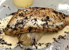 Sauteed Turbot with Braised Endive, Celery Root Flan, Black Truffles, and Garlic Nage from Neal Fraser of Grace Restaurant in LA