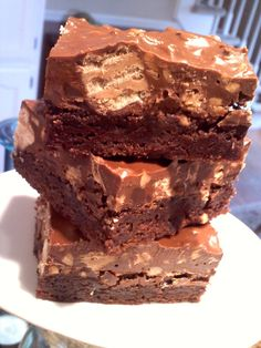 Peanut Butter Blotto Brownies... brownies topped with chocolate chips, melted peanut butter and chocolate, chopped nuts and Nutty Bars!!!
