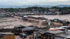 04/04/2016 - Pakistan floods kill at least 53 after heavy rains - [photo: swollen river washing away ramshackle shops]