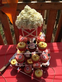 Farm animal cupcake and cake smash tower. Perfect for a farm themed first birthday! Cows, Pigs and Chicks
