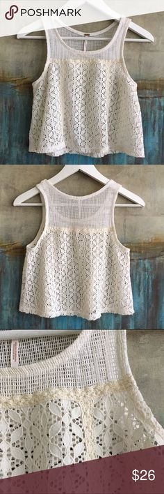 Free People Lace Tank Size XS Oh so pretty Free People lace tank with feminine texture and cropped design. Size XS. Color Beige. Material Cotton/Poly. Measurements shoulders: 9.5, pits: 15.5, top to  bottom: 17. Free People Tops Tank Tops