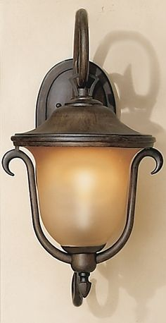 The Santa Barbara Wall Sconce is crafted from top-quality materials for years of service. A truly premium outdoor lighting fixture, this sconces graceful curves and inviting warm hues beautify your all-weather rooms.