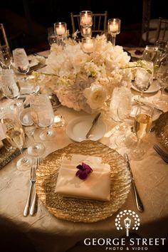Love this for a low centerpiece!  Flowers and candles...  Perfect!