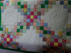 scrappy 30's triple Irish chain. The bright  pink squares make this quilt pop.